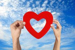 Hands holding heart shape with blue sky Royalty Free Stock Photos