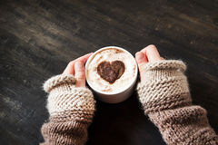 Hands Holding Heart Shape Cappuccino Stock Photos