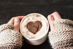 Hands Holding Heart Shape Cappuccino Stock Photography