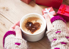 Hands Holding Heart Shape Cappuccino Stock Images