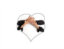 Hands holding a heart shaped ad space Stock Image