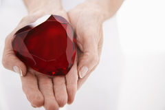 Hands Holding Heart Shaped Jewel Royalty Free Stock Photography