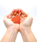 Hands holding heart Stock Photography