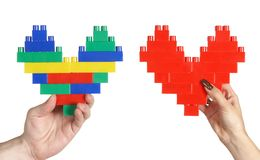 Hands holding hearts Royalty Free Stock Images