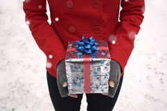Hands Holding Holiday Gift. Winter holiday background, with hands holding a holiday Gift box. Representing giving presents stock photography