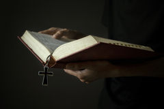 Hands holding holy bible Royalty Free Stock Image