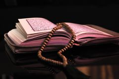 The Holy book of muslims/ Quran hands hold the koran. Hands Holding holy book of muslims on the black background Royalty Free Stock Photo