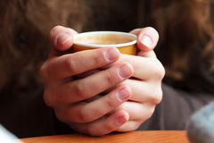 Hands holding hot coffee Royalty Free Stock Photo