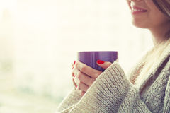 Hands holding hot coffee or tea Royalty Free Stock Image