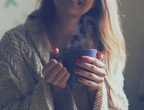 Hands holding hot coffee or tea Royalty Free Stock Photo