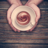 Hands holding hot cup of coffee Royalty Free Stock Photography