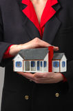 Hands Holding House Stock Photo