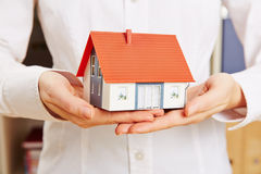 Hands holding house as insurance Royalty Free Stock Images