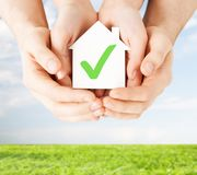 Hands holding house with check mark Royalty Free Stock Photo
