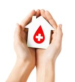 Hands holding house with donor sign Stock Images