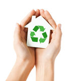 Hands holding house with green recycling sign Royalty Free Stock Image