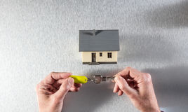 Hands holding a house key to the management of property Royalty Free Stock Photography
