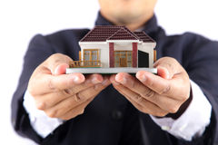Hands holding a house Stock Photo