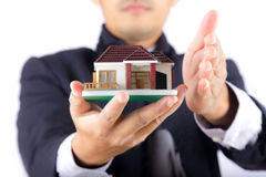 Hands holding a house Stock Photos