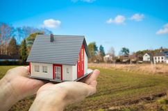 Hands holding a house model Stock Photos
