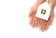 Hands holding a house model. On a white background Royalty Free Stock Photos