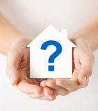 Hands holding house with question mark Royalty Free Stock Images