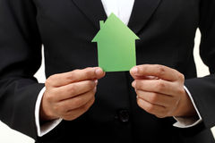Hands holding house shape. Business woman hands holding house shape Stock Images