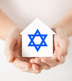 Hands holding house with star of david Stock Photo