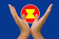 Hands holding  icon of Asean Economic Community Stock Photo