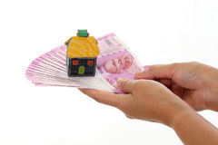 Hands holding Indian currency with house shape Stock Image