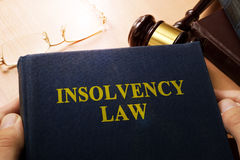 Hands holding insolvency law. Company bankruptcy concept Stock Image