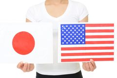 Japan and America national flag. Hands holding Japan and America national flag stock images