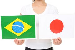 Japan and Brazil national flag. Hands holding Japan and Brazil national flag stock images