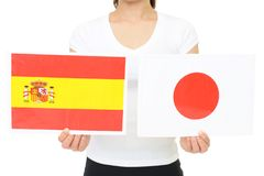 Japan and Spain national flag. Hands holding Japan and Spain national flag stock photo