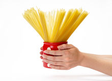Hands holding jar with spaghetti Stock Photo