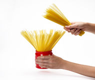 Hands holding jar with spaghetti inside Royalty Free Stock Photos