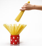 Hands holding jar with spaghetti inside Stock Photography