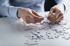 Hands Holding a Jigsaw Puzzle Stock Images