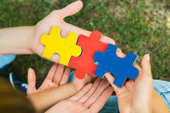 Hands Holding Jigsaw Puzzle Pieces Royalty Free Stock Photos
