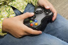 Hands Holding a Joystick Controller while playing a video games royalty free stock images