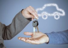 Hands Holding key with car icon in front of vignette Royalty Free Stock Images