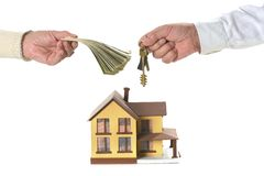 Hands holding keys and dollars at miniature house Royalty Free Stock Images
