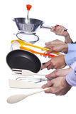 Hands holding kitchenware tools. Group of people hands holding some kitchenware tools (selective focus Royalty Free Stock Photos