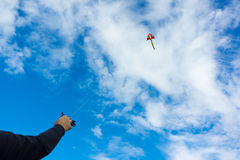 Hands holding kite Stock Images