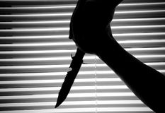 Hands holding knife Stock Images