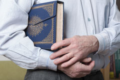 Hands holding the Koran royalty free stock photography