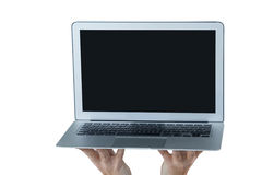 Hands holding laptop against white background. Close-up of hands holding laptop against white background royalty free stock image
