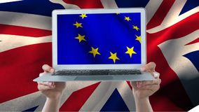 Hands holding a laptop with european flag