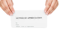 Hands holding a letter of appreciation Royalty Free Stock Photo
