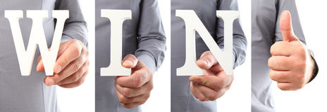 Hands holding letter text win word Royalty Free Stock Photos